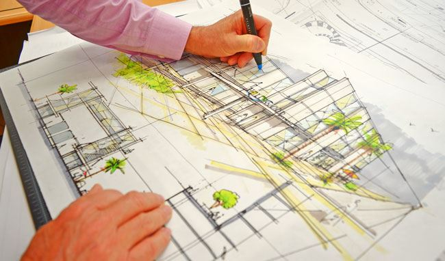 Architect coloring in design sketch