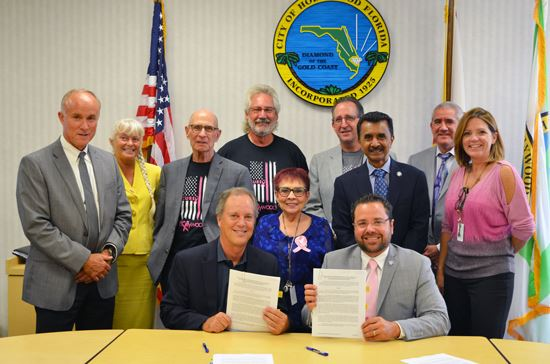 Commission Signing Housing Pride Program Agreement